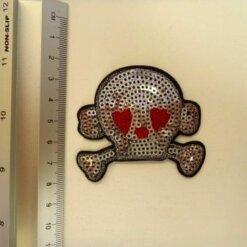 sequin skull motif